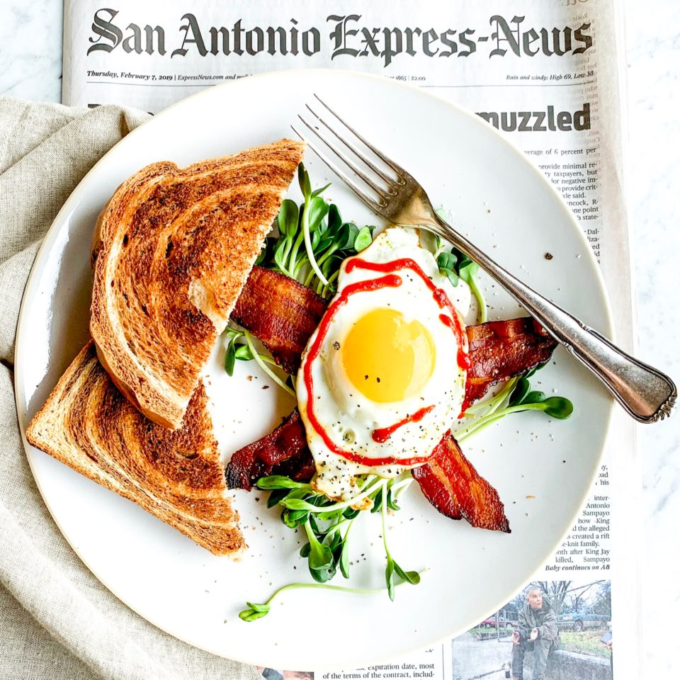 Marble Rye Toast w/a Sunny Egg, Sprouts & Bacon